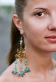 женщина серег Стоковые Фотографии RF