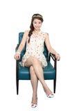 Женщина сидя на стуле Стоковые Фотографии RF