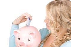 женщина симпатичных дег банка piggy Стоковое Фото