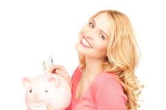 женщина симпатичных дег банка piggy Стоковое фото RF