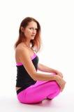 Женщина сидя в положении лотоса Стоковое Изображение