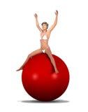 Женщина сидя на гигантском шарике фитнеса Стоковое фото RF