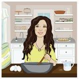 Женщина смешивая в кухне Стоковое Изображение