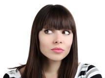Женщина смотрит на белой предпосылке Стоковые Изображения RF