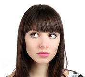 Женщина смотрит на белой предпосылке Стоковое Изображение RF