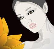 Женщина смотрит цветок Стоковое фото RF