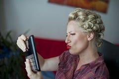 Женщина смотря в зеркале Стоковые Фото