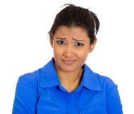 Женщина смотря подозрительный Стоковое Фото