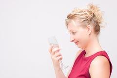 Женщина смотря стекло Стоковые Фото