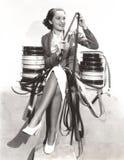 Женщина смотря filmstrips Стоковое Изображение RF