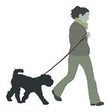 женщина собаки гуляя Стоковое Фото