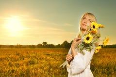 женщина солнцецветов Стоковые Изображения