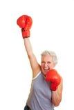 женщина спички коробки старшая выигрывая Стоковые Фотографии RF