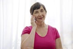 женщина старшия клетки Стоковое фото RF
