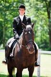 женщина старшия riding horseback Стоковые Изображения RF