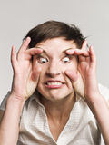 женщина стороны смешная делая Стоковое Изображение RF