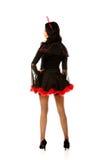 Женщина стоя в одеждах дьявола Стоковые Изображения RF