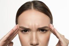 Женщина страдает от повреждения Стоковые Изображения RF