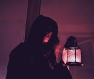 Женщина с лампой Стоковая Фотография