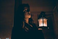 Женщина с лампой Стоковая Фотография RF