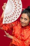 Женщина с вентилятором стоковая фотография