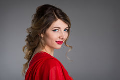 Женщина с волосами в платье вечера красном Стоковое фото RF