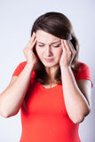 Женщина с головной болью Стоковое фото RF