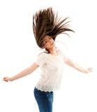 Женщина слегка ударяя ее волосы Стоковые Изображения RF