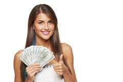 Женщина с деньгами доллара США Стоковая Фотография