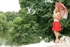Женщина с зонтиком Стоковая Фотография