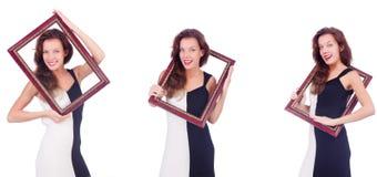 Женщина с картинной рамкой на белизне стоковые изображения rf