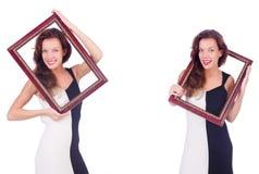 Женщина с картинной рамкой на белизне стоковые фото