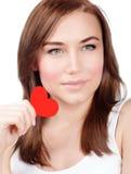Женщина с красным сердцем Стоковые Фотографии RF