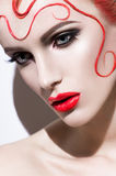 Женщина с красным сторон-искусством Стоковое Изображение