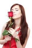 Женщина с красным цветом подняла на белизну Стоковое Изображение RF