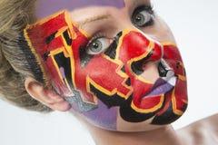 Женщина с красочной краской стороны Стоковые Фотографии RF