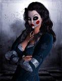 Женщина с маской клоуна стоковая фотография rf