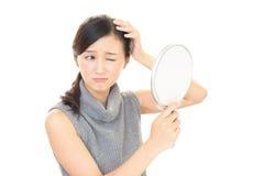 Женщина с неловким взглядом Стоковое фото RF
