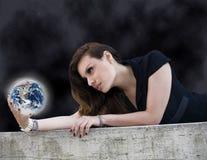 Женщина с планетой Стоковая Фотография RF