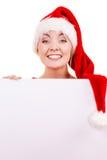 Женщина с пустой пустой доской знамени Рождество Стоковое Фото