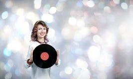 Женщина с плитой диско Стоковые Фотографии RF