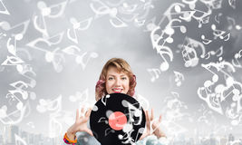 Женщина с плитой диско Стоковая Фотография RF