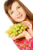 Женщина с связкой винограда стоковое фото