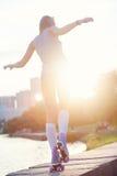 Женщина с скейтбордом Стоковая Фотография RF
