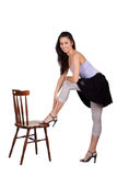 Женщина с стулом Стоковое Изображение