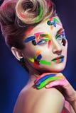 Женщина с творческим составляет стоковые изображения