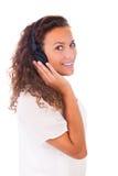 Женщина слушая к музыке с наушниками Стоковое фото RF