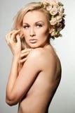 Женщина с цветками Стоковые Фотографии RF