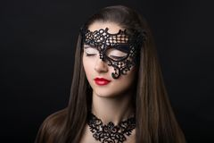 Женщина с черной маской Стоковая Фотография RF