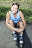 Женщина с rollerblade в временени стоковое фото rf